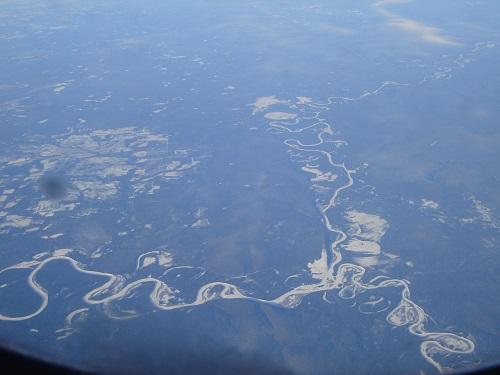 ロシア上空の機内から見た大河